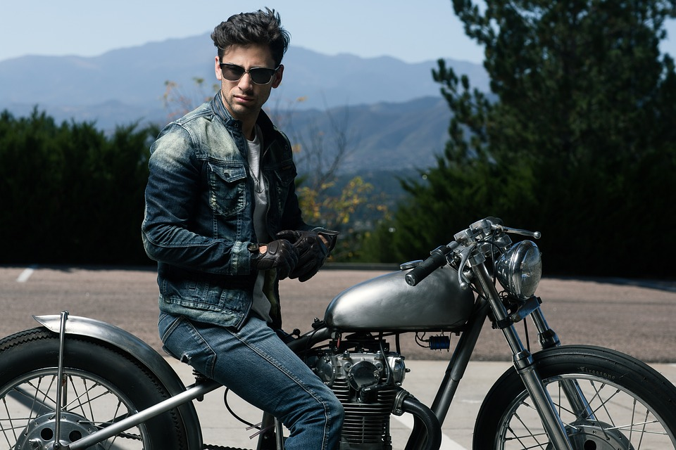 action adult adventure bike biker cyclist fun glasses gloves leisure man motorcycle mountains outdoors people recreation road sitting transportation system travel vehicle wheel woman biker man man man man man motorcycle motorcycle people